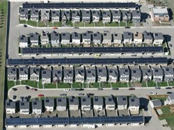 An aerial view of the completed solar community