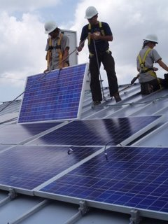 "Julio Cardoza (middle), an LCTN solar installation trainee, worked with the South Coast Solar staff as ""lead installer"" on Wednesday's installation"