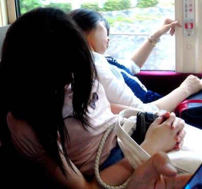 girls sleeping in the bus