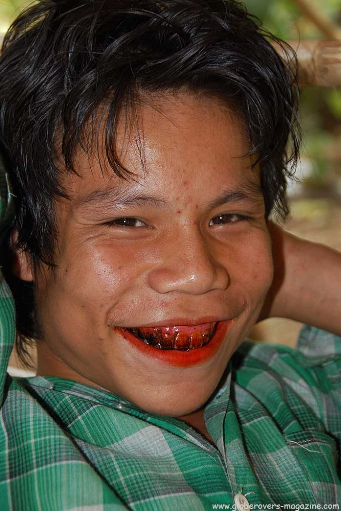 Portaits - boy with red betel nut mount in Village of Kinmun, MYANMAR