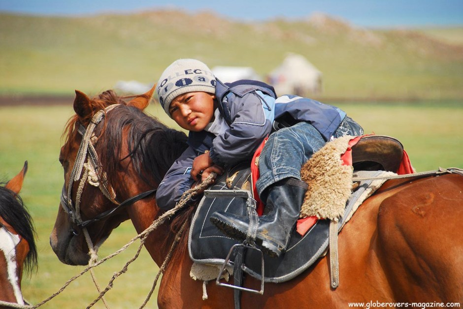 This little guy knows his horse so well. Kids are on their horses from a very young age. Just like many other kids in developed countries are on their PlayStations from a very early stage. Song kul Lake, Kyrgyzstan