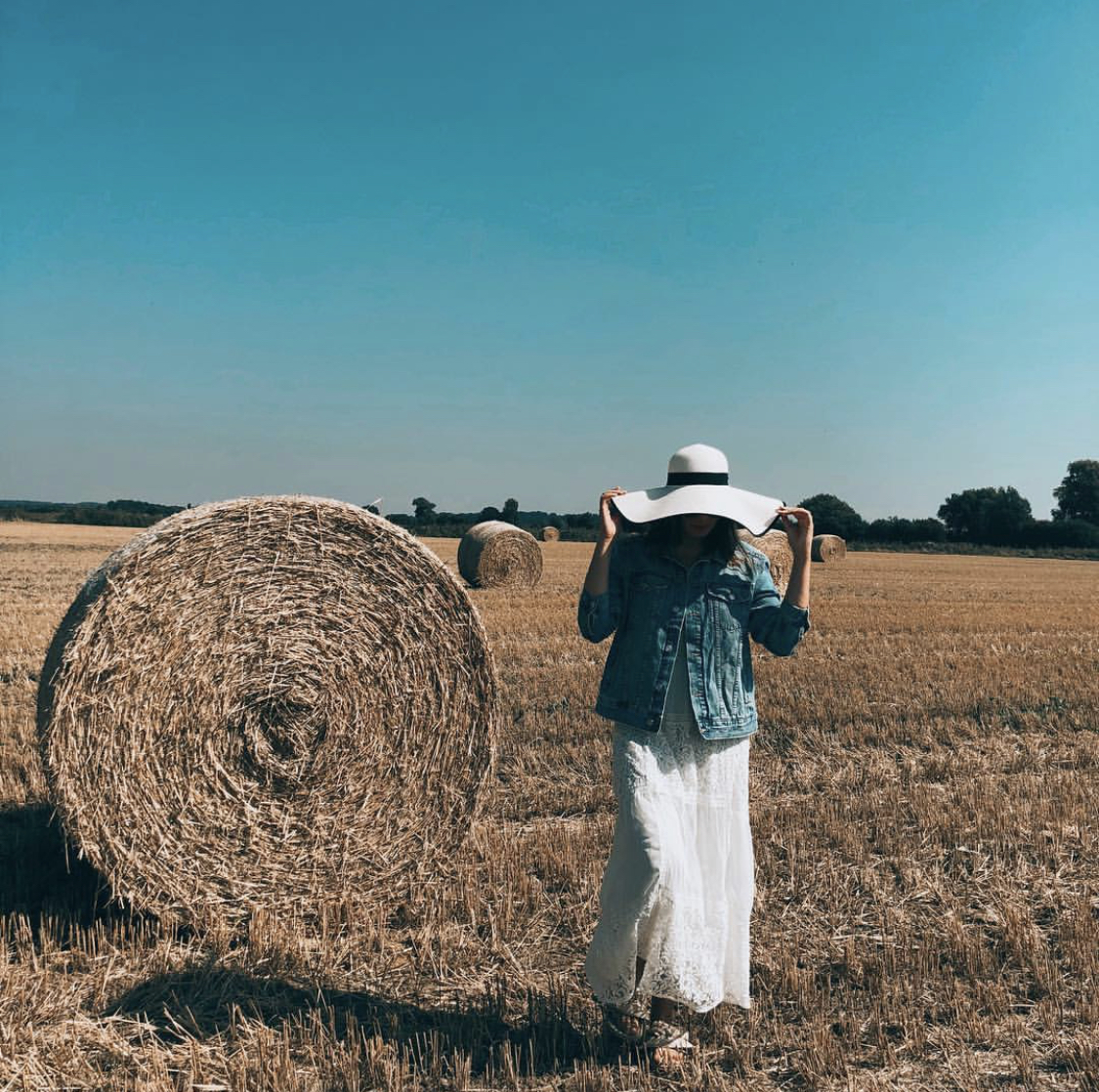 UK STAYCATION IDEAS: English summer field with hay stacks