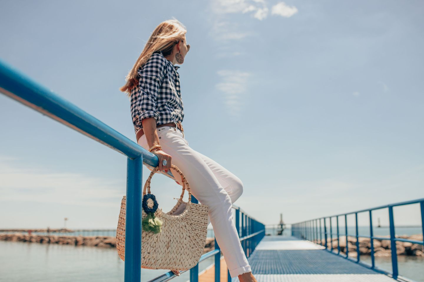 Georgia Arnold of Gloss and Harbour wearing a Navy Gingham Button with white jeans on Lake Michigan in Milwaukee, WI