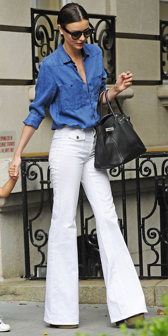 Women Wearing White Flare Jeans and Blue Button Down for a Timeless Summer Holiday Look