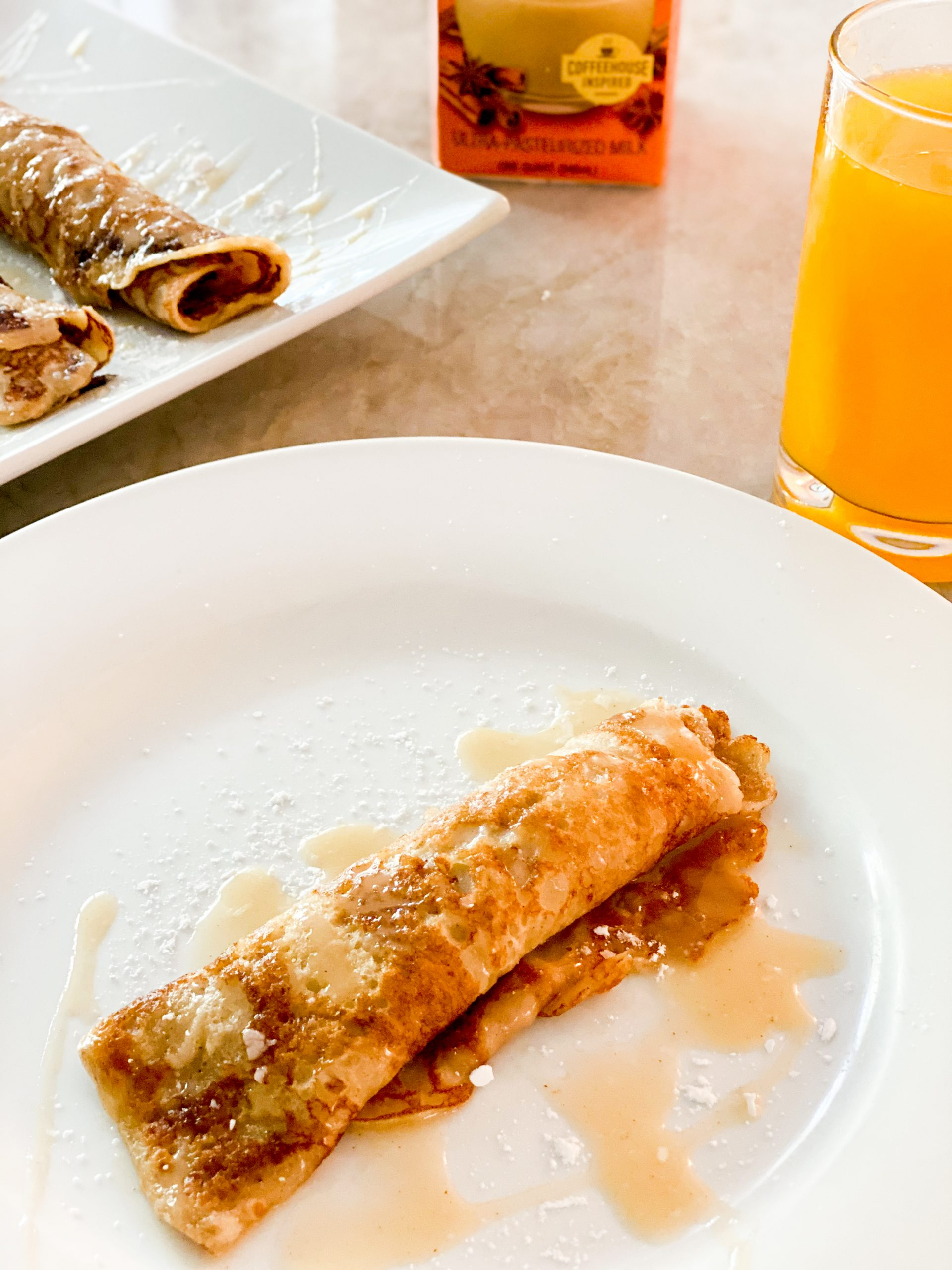 Pumpkin Spice Crepes with a Pumpkin Spice Glaze for a delicious fall breakfast.