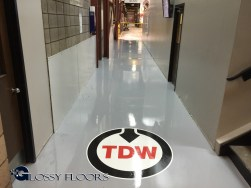 TD Williamson industrial epoxy floor with logo Industrial Epoxy Floor With Logo 2015 08 02 19