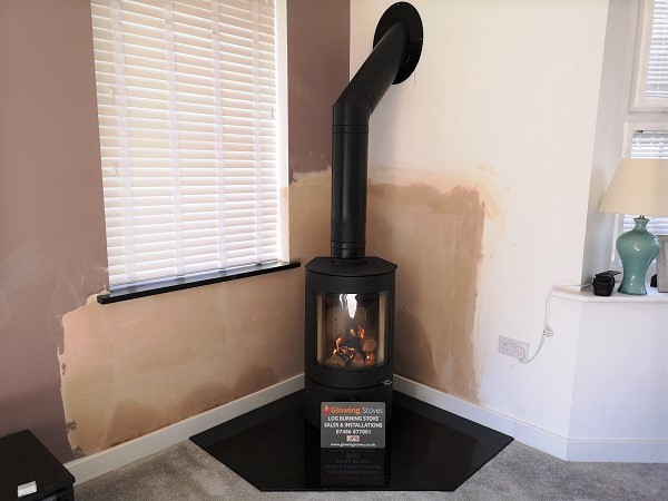 Freestanding stove with a twin wall chimney system in Taunton.