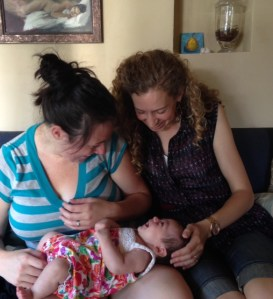 baby smiling with Angela and mother