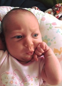 baby with hand on face