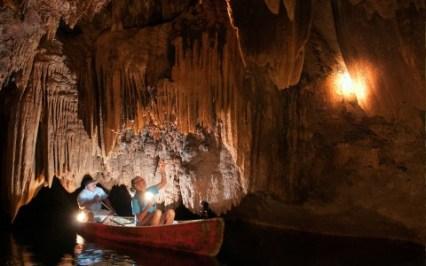 Exploring Hidden Valley Cave in a canoe in Belize.