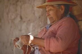 A chilean woman knitting.