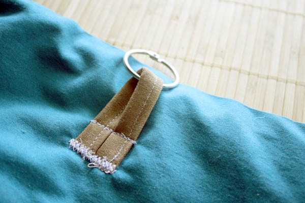 This homemade dog treat bag attaches to a belt loop, so your hands can be free to work with your dog, and your pockets won't smell like dog treats later.