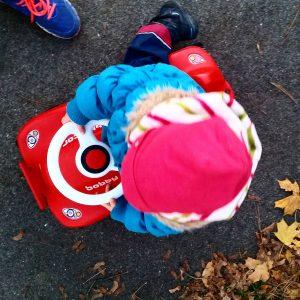 Foto Kind auf Bobbycar