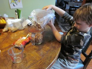 Corbin measures the Cocoa Rice Krispies