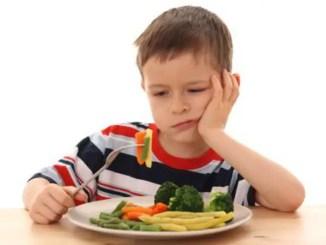 Boy Eating Veggies