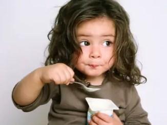 Girl Eating Yogurt
