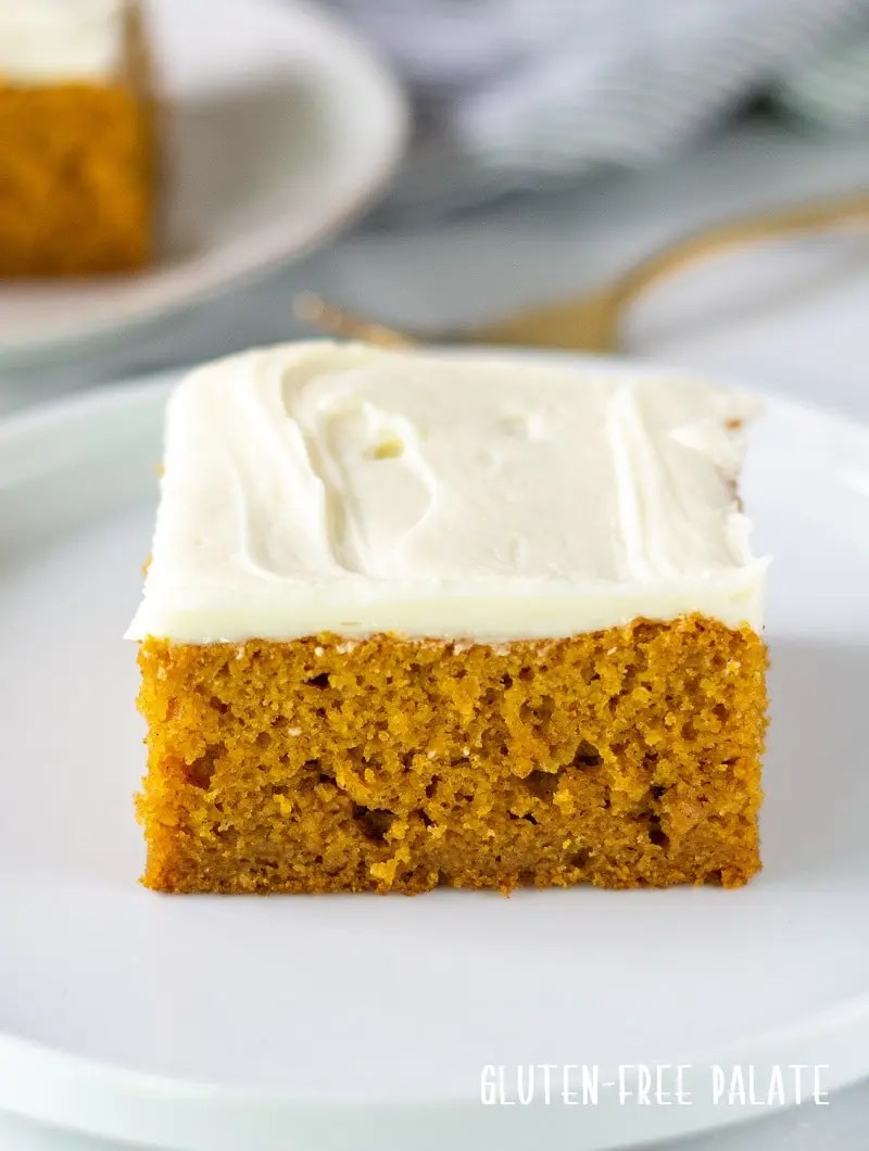 a slice of gluten free pumpkin cake on a white plate