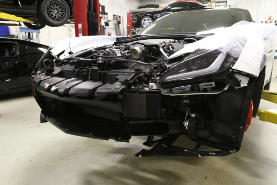 With the front fascia removed work can begin on getting the engine bay ready for the air shroud, intercooler, P-1SC head unit, and piping.