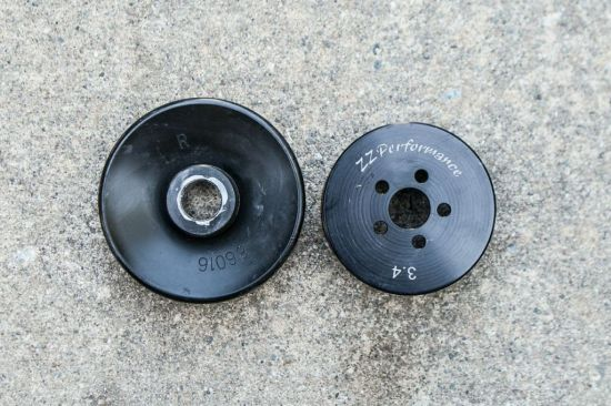 A smaller ZZP 3.4-inch pulley joined the party for more boost and more power. Note how much smaller it is than the stock unit.