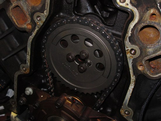 The main thing you'll need to convert the L92/L94/L9H to LS3 standard is the LS3 timing cover (part no. 12633906) and three-bolt timing chain set (available from manufacturers such as Comp Cams, Summit Racing, Chevrolet Performance). You can install pretty much any cam you desire in place of the stock cam. For our setup, we went with a budget friendly C6 ZR1 cam we had at the shop. We also switched the valvesprings to LS3 spec springs. Since our engine was going into a C5, we needed to install the oil pan from the LS6 we pulled out of the car.