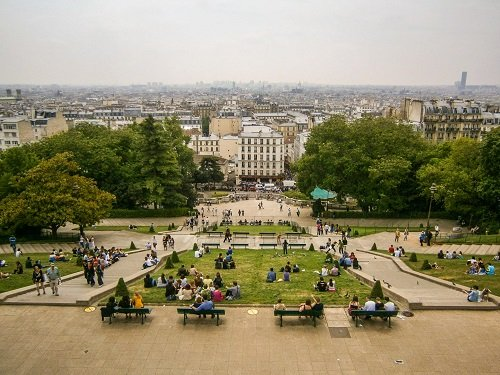 The view from atop the Sacre Coeur is beautiful, but almost not worth the harassment.