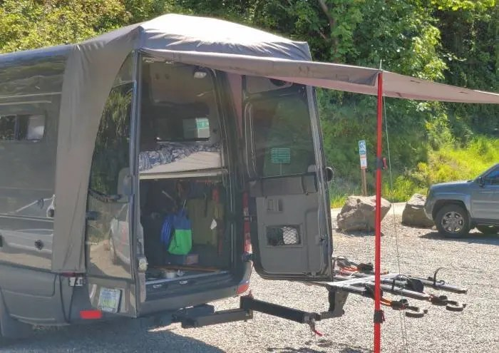 Van privacy curtain raised for awning