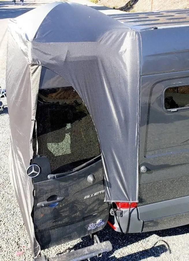 Rear door canopy on sprinter van.