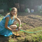 De tuin in met de kinderen