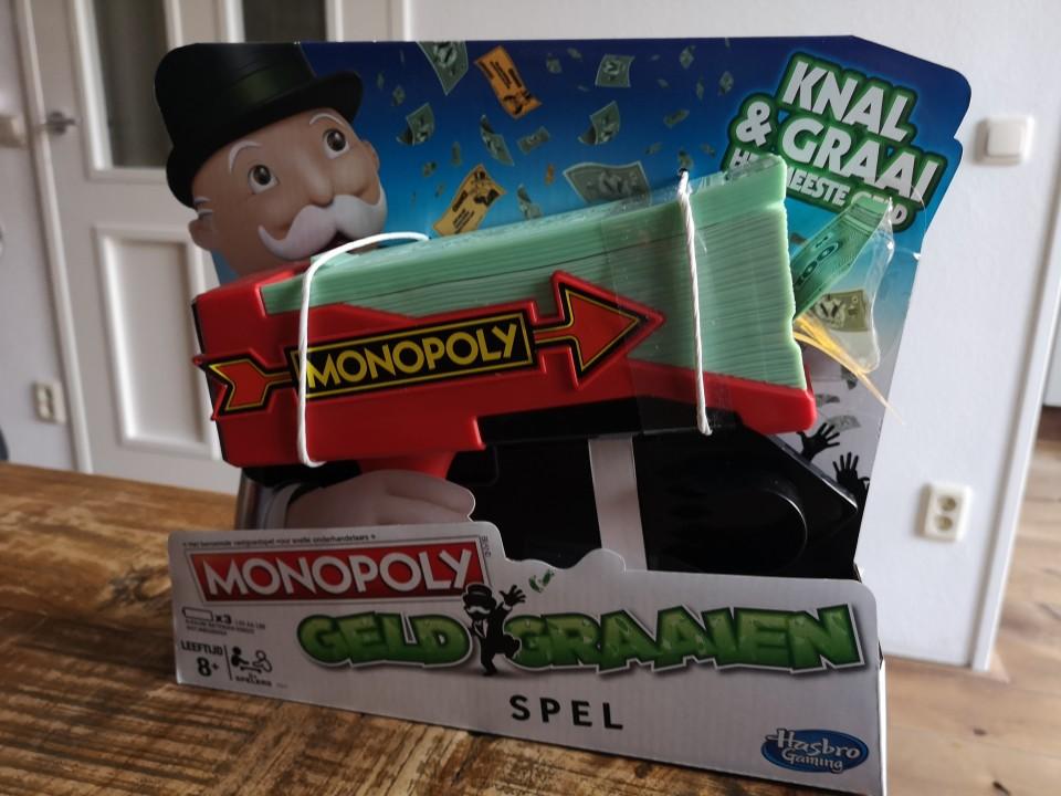 Monopoly geld graaien apparaat