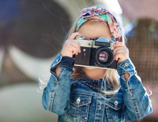 ogen meisje met camera foto's kind