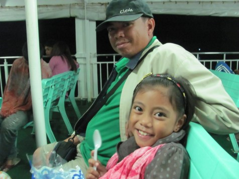 Joel and his daughter Cesky on the ferry boat, during their trip to Manila