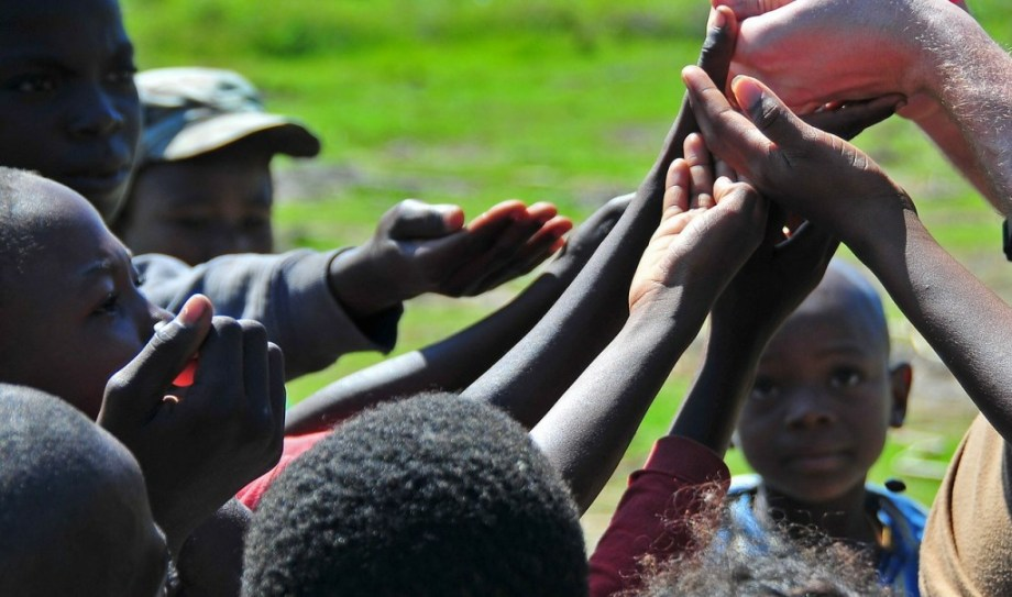 Children in Haiti putting their hands together