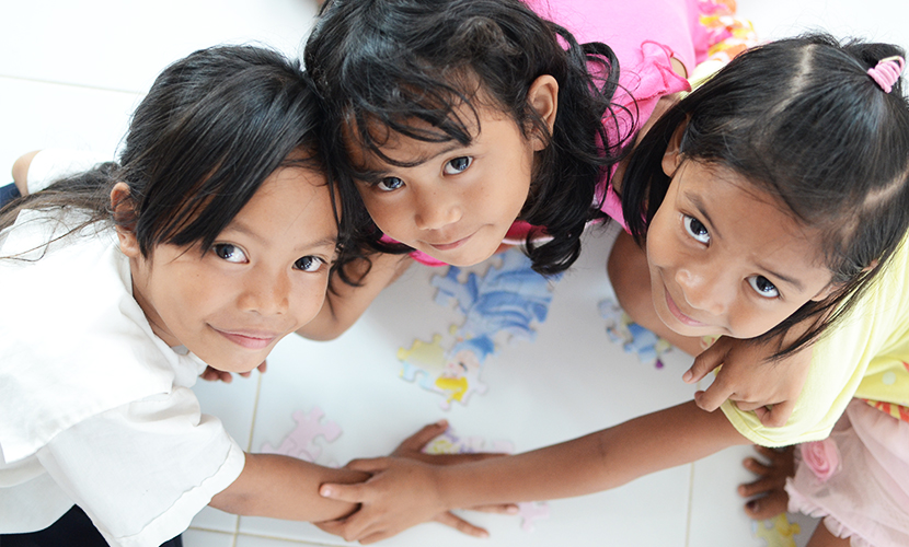 Three little girls playing
