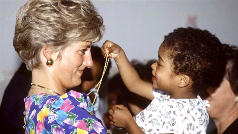 Princess Diana with a child