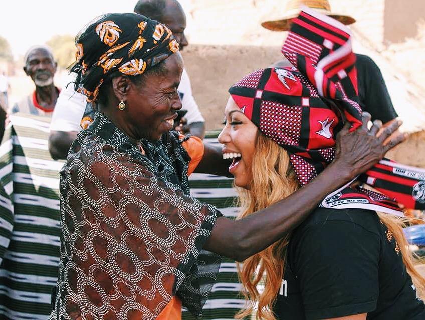 Volunteer with local woman in Burkina Faso