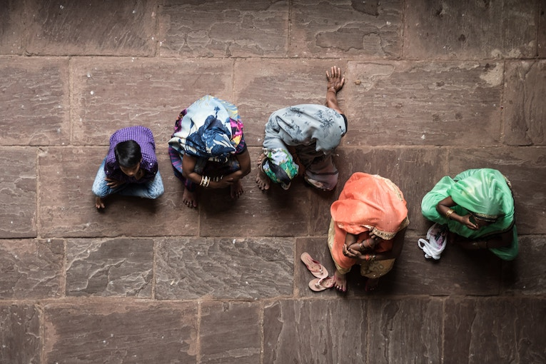 group of Indian women sitting on floor