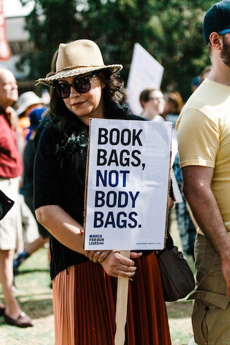 woman holding a picket sign
