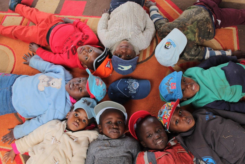 Children laying on the floor in a circle in Swaziland