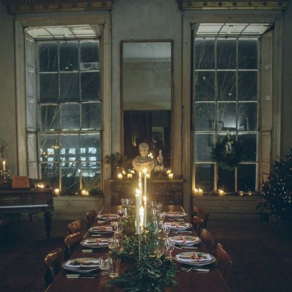 Atmospheric candlelit tablescape and antique mirror