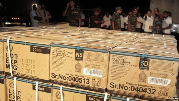 Aid - such as this material from Sri Lanka - has gradually started to arrive in Nepal
