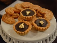 Chocolate tarts with gold leaf