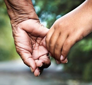 Young hand holding an older hand