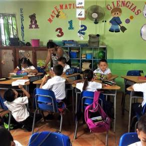 Volunteer teaching young students in Costa Rica