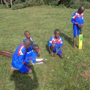 Boys preparing to play cricket