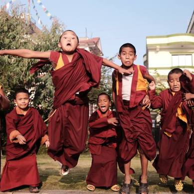 Young monks playing outside
