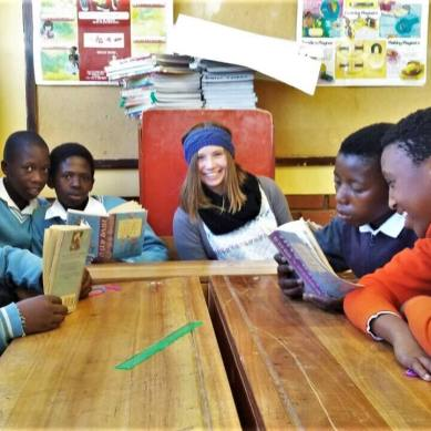 Volunteer and students reading