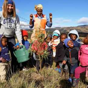 Volunteer with a group of young children in South Africa