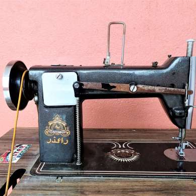 Manual powered sewing machine