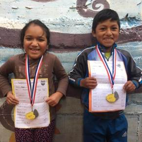 Reading Champion students showing off their medals