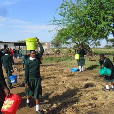 Students in Tanzania planting trees
